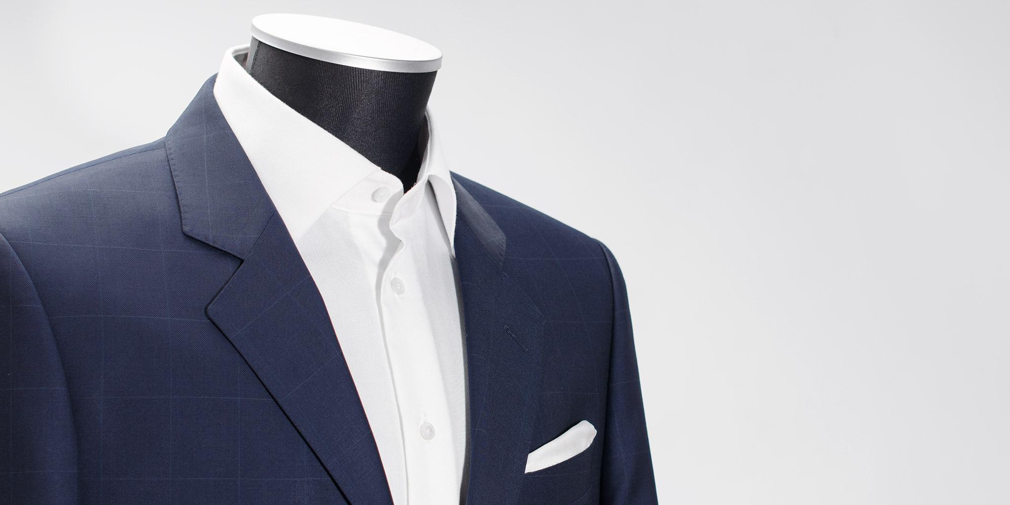 Blå dress med ruter i stoffet Ermenegildo Zegna Traveller Microsphere.